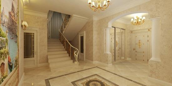 Большой холл в доме с лестницей на второй этаж
