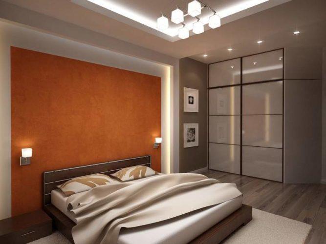 Акцентная оранжевая стена в спальне