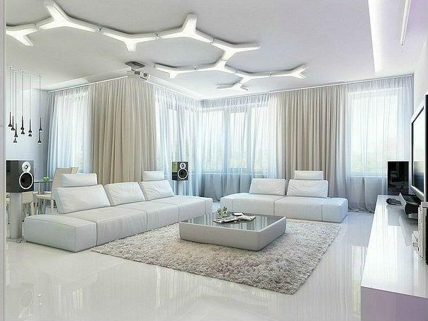 Дизайн пола в просторной гостиной белого цвета