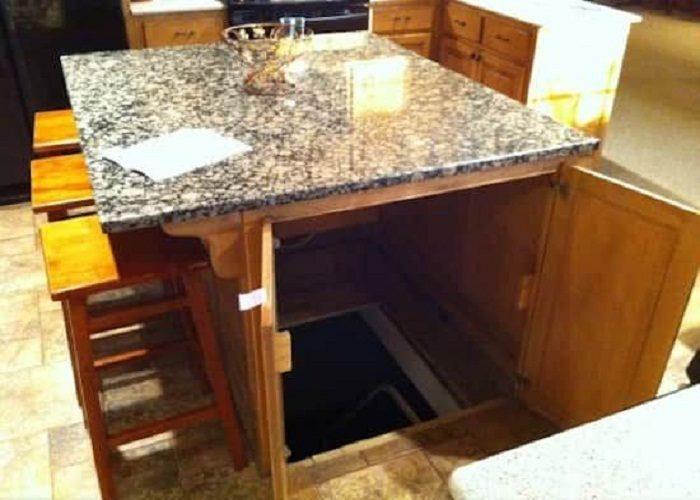 Вход в подвал под столом